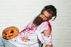 Zombie man with Halloween pumpkin Royalty Free Stock Photos