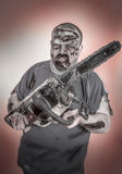 Zombie with mechanical saw. Is a man disguised as a zombie one with mechanical saw royalty free stock image