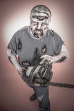 Zombie with mechanical saw. Is a man disguised as a zombie one with mechanical saw Stock Photo