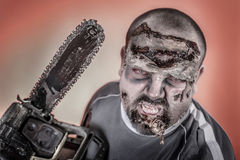Zombie with mechanical saw. Is a man disguised as a zombie one with mechanical saw Royalty Free Stock Images