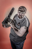 Zombie with mechanical saw. Is a man disguised as a zombie one with mechanical saw Royalty Free Stock Photography