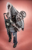 Zombie with mechanical saw. Is a man disguised as a zombie one with mechanical saw Stock Images