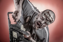 Zombie with mechanical saw. Is a man disguised as a zombie one with mechanical saw Royalty Free Stock Photo