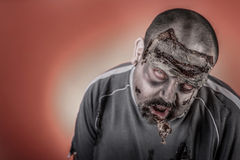 Zombie with mechanical saw Royalty Free Stock Photos