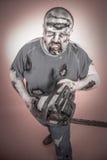 Zombie met mechanische zaag stock foto