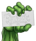 Zombie Monster Hand Holding Happy Halloween Sign Stock Photography