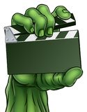 Zombie Monster Horror Film Movie Clapper Board. Zombie or Halloween monster hand holding movie clapper board with copy space for text. Could be concept for Stock Photo