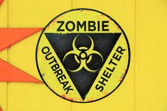 Zombie Outbreak Shelter Sign. Shelter is available in the event of a zombie outbreak. Follow the signs Stock Photography