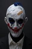 Zombie pazzi del pagliaccio rossi in un rivestimento Fotografia Stock Libera da Diritti