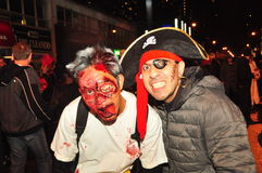 Zombie and Pirate at Zombie Crawl and Parade, Toronto, Canada. Costumed men dressed as zombie and pirate on Church Street during the 2015 Zombie Crawl and Parade Royalty Free Stock Photo