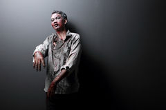 Zombie. Portrait of a Zombie standing with black background Royalty Free Stock Photo