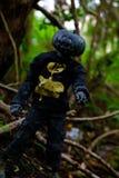 Zombie Pumpkin Black. Halloween pumpkin head with a zombie in the woods Stock Photo