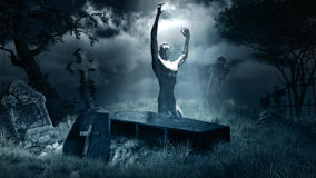Zombie rising from grave Stock Photo