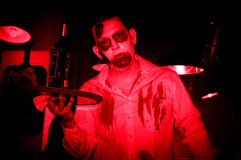 Zombie serving wine during halloween Stock Photography