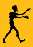 Zombie Silhouette. Silhouette of a Zombie walking in Orange Background vector illustration