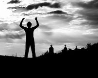 Zombie silhouette. Silhouette shot of a zombie with cemetery background Royalty Free Stock Photography