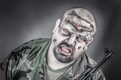 Zombie soldier. Is a disguised military soldier with a rifle Stock Images