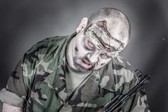 Zombie soldier. Is a disguised military soldier with a rifle royalty free stock photos