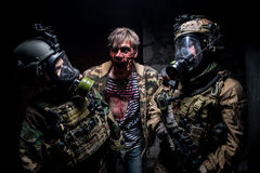 Zombie and soldiers Stock Photos