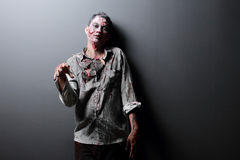 Zombie. Standing with black background hand up scaried Stock Images