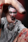 Zombie. Standing looking camera close up two hand Royalty Free Stock Image