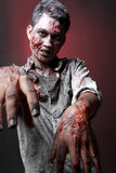 Zombie. Standing  looking camera two hand close up scariied Royalty Free Stock Photos