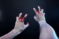 Zombie stretching bloody hands. First person point of view Stock Photography
