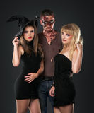 Zombie vampire and witch  in the dark studio Stock Photo