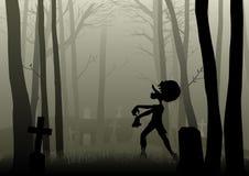 Zombie walking on the graveyard in dark woods Royalty Free Stock Image