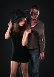 Zombie and witch in the studio Royalty Free Stock Images