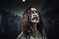 Zombie woman with bloody face. Portrait of the horror zombie woman with bloody face Royalty Free Stock Images