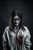 Zombie woman with bloody face Royalty Free Stock Photography