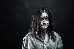 Zombie woman with bloody face stock photography