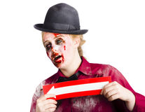 Zombie woman giving directions Royalty Free Stock Images