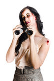 Zombie woman with binoculars Stock Photos