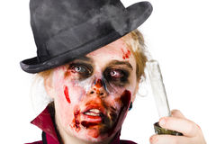 Fearful zombie woman holding blown out candle Stock Image