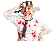 Zombie woman with cooking pan on her head Royalty Free Stock Photography