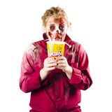 Zombie woman with popcorn Stock Image