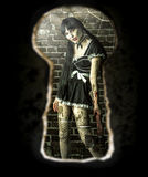 Zombie woman in the room - view of the keyhole of the door Stock Photos