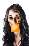 Zombie woman with mouth covered Stock Images