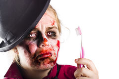 Zombie woman with toothbrush Stock Images