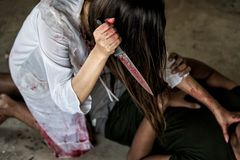 Zombie woman or Woman Ghost holding knife will kill man people. With blood, halloween concept royalty free stock photography