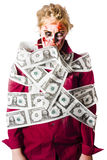 Zombie woman wrapped in money Stock Images