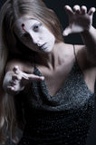 Zombie with wound on forehead royalty free stock image