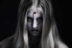 Zombie with wound on forehead Stock Photos