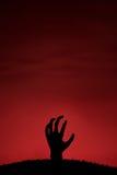 Zombiehand die omhoog komen Stock Foto's