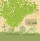 Zombiehand die uit zijn graf komen Stock Foto