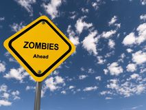 Zombies ahead. Traffic sign on blue sky royalty free stock photo