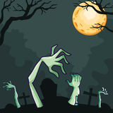 Zombies coming out of the grave at night Royalty Free Stock Photography