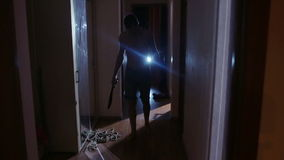 Zombies maniac with a knife down the hallway. horror stock video